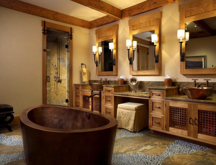 decoración baño rústico moderno, muebles auxiliares, lavabo doble y tocador, madera y piedra, espejos enmarcados, bañera èqueña redondeada