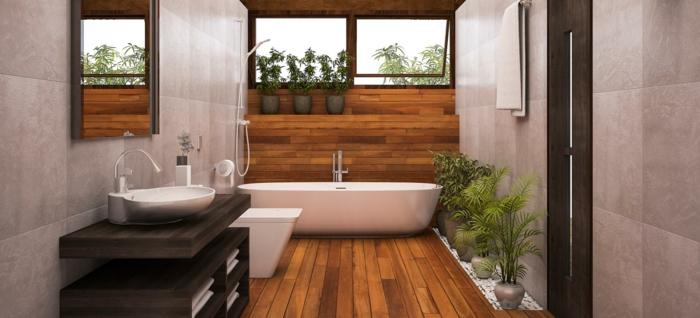 bañera moderna exenta y armarios modernos, azulejos para baños en las paredes, techo revestido de parquet y decoración de plantas verdes