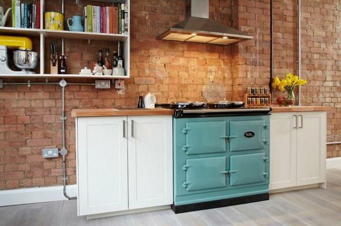 cómo diseñar cocinas en estilo industrial, idea funcional con muebles de doble función, estantería para libros con decoración en estilo vintage
