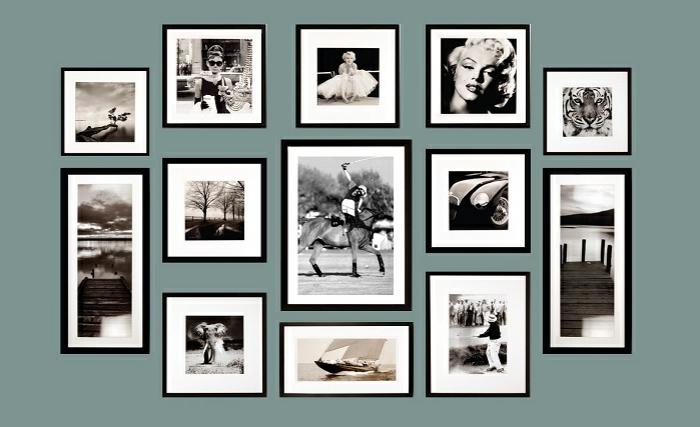 ideas para fotos, pared decorado con imagenes en blanco y negro con marcos en negro, fotos de Marilyn Monroe y otros celebridades