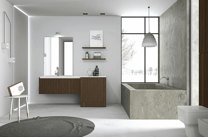 mueble lavabo, baño gris, bañera de granito rectangular, ventana grande, armarios de madera, tapete redondo, silla con retro radio