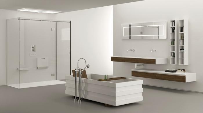 baño blanco original, armarios de baño, ducha con plato y mámpara de vidrio, bañera rectangular diseño moderno, estanterías de madera, suelo con baldosas gris