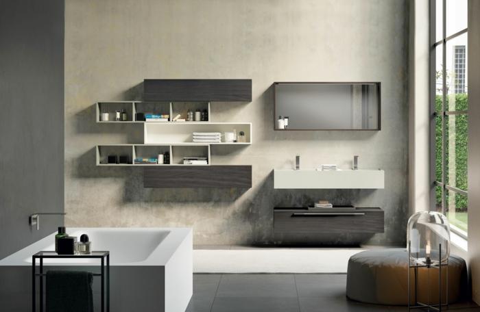 baño moderno con ventana grande, armarios de baño, bañera rectangular, estantes de madera, lavabo doble, suelo con baldosas y tapete beige