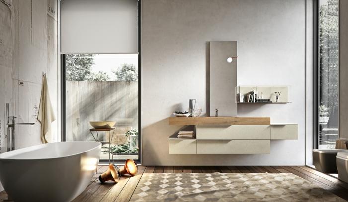 estilo nórdico, armario baño, baño con luz natural, bañera ovalada, tonos vbeige, suelo con tarima, tapete, espejo alto, mueble de lavabo de madera y plástico