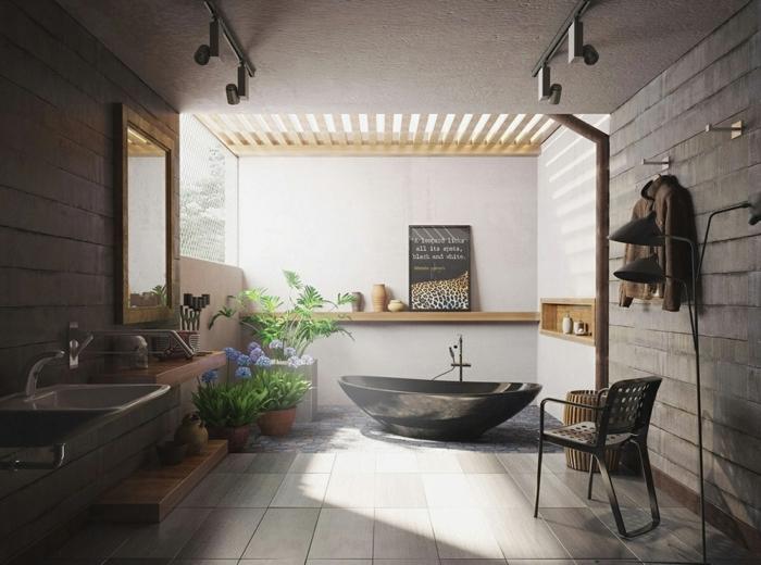 baño moderno con toque rústico, mucha luz natural, muebles de baño, bañera negra, espejo con marco de madera, macetas con flores, silla y chimenea pequeña