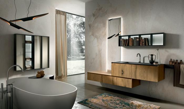 baño elegante con bañera y alfombra, espeo alto, mueble lavabo de madera rústica, encimera negra, lámpara colgante original