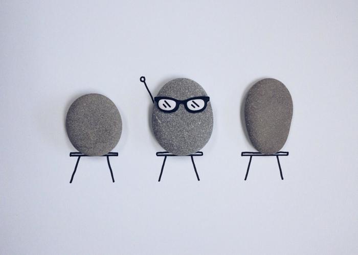 ideas para dibujar, decoración divertida con piedras grises sobre hojas de papel dibujada, pidra con gafas de sol, manualidades fáciles