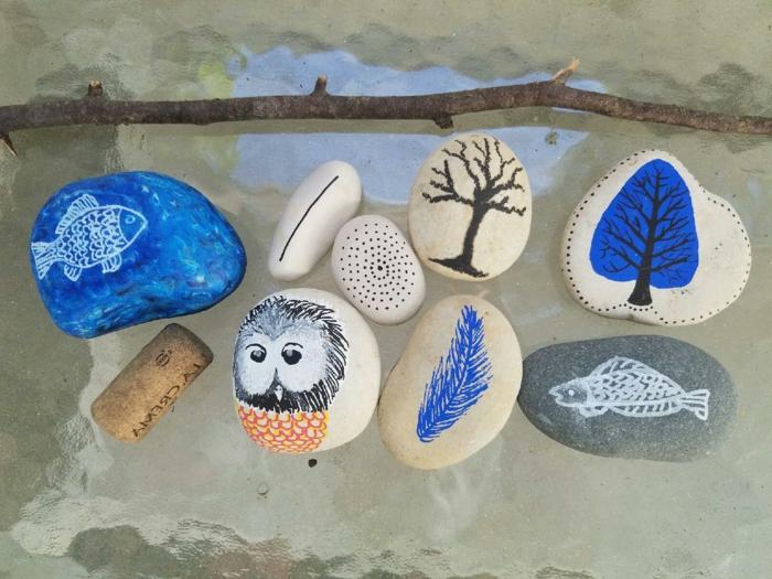 piedras para jardin, piedras pintadas sobre vidrio, peces, arboles y buho, pintura acrilica, manualidades faciles