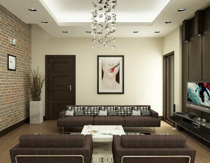 colores para salones, sal'in en colores terrosos, pared de ladrillo visto, luces empotradas en el techo, marrón y beige, mesa pequeña blanca