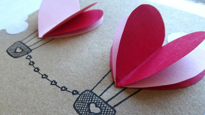 tarjetas DIY con paracaídas hechas de corazones, ideas románticas dia de san valentin, como sorprender a mi novia