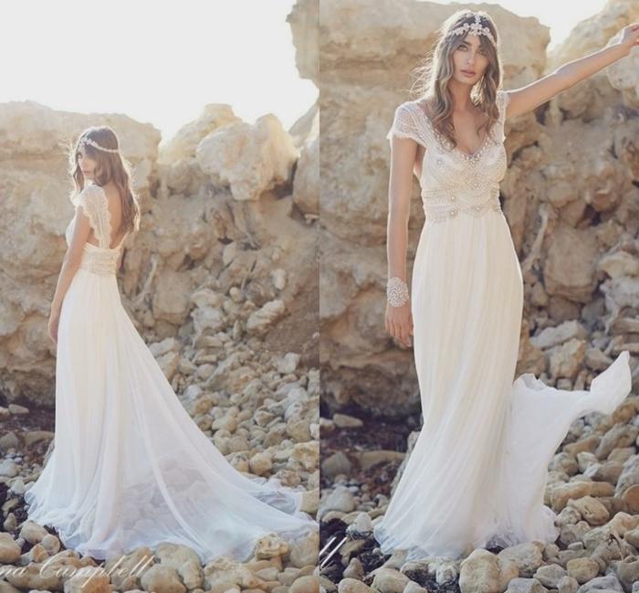 vestido blanco ibicenco, mujer en la playa, vestido de novia largo, falda con tul, mangas cortas, escote v, encaje y piedras decorativas