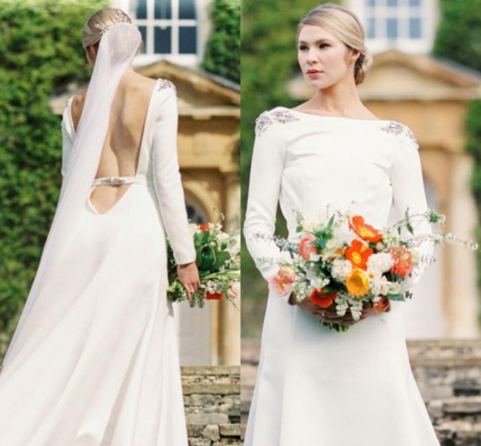 vestido novia sencillo, vestido sencillo con espalda descubierta y ornamentos en los hombros y la cintura, pelo en moño y largo velo
