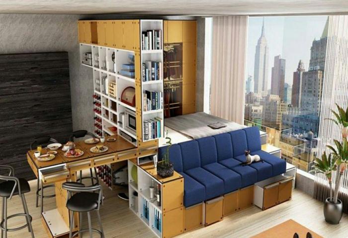 separadores de ambientes, precioso interior, habitación que cumple la función de dormitorio, salón y comedor, grandes ventanales con vista al Nueva York