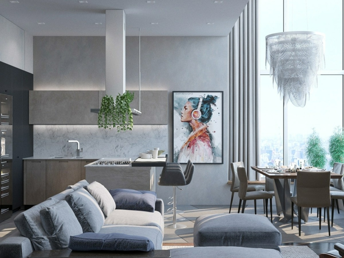tendencias en el diseño de cocinas abiertas al salon, ambiente en gris, decorado de plantas verdes y pintura, sofa en los tonos de gris y beige