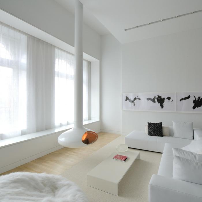preciosa decoración en estilo nórdico con chimenea de leña en blanco, salones minimalistas en blanco