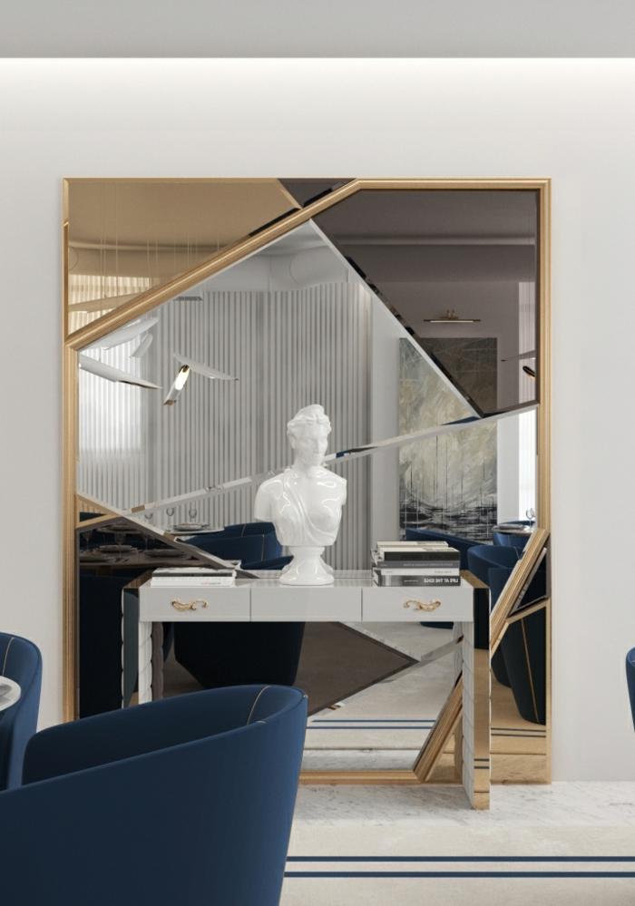 precioso espacio en estilo vintage con elementos en azul y dorado, estatua blanca decorativa, decoracion con espejos grandes en forma rectangular