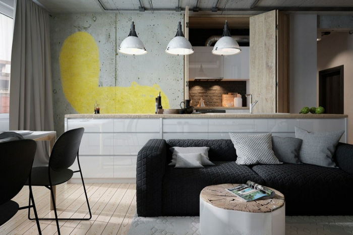 diseño de cocina en estilo industrial, cocinas abiertas al salon en blanco y negro, lámparas vintage y sofa en negro