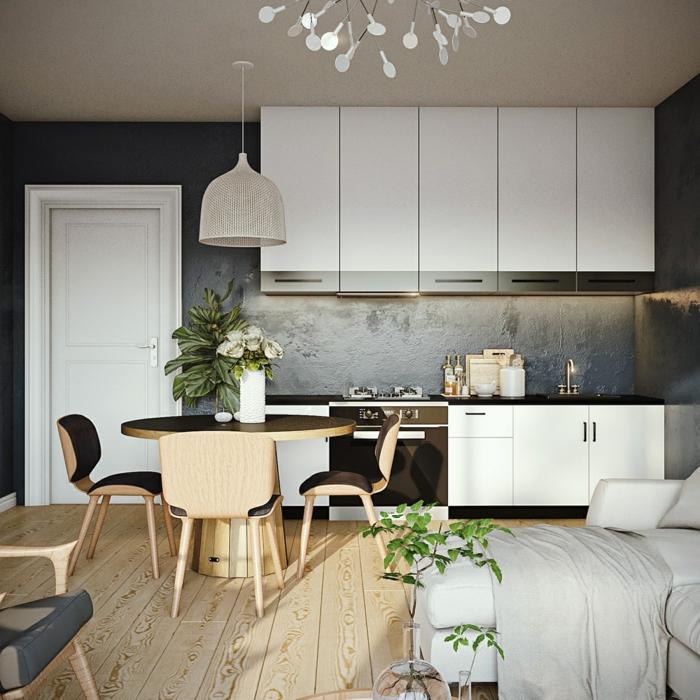 cocina de encanto con pequeño comedor, cocinas abiertas al salon decoradas de manera original y acogedora, mesa oval y decoracion de plantas verdes
