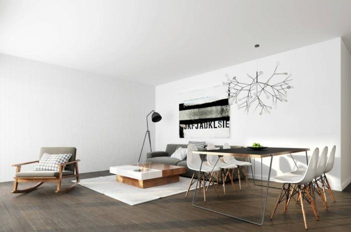 decoracion salon moderno en estilo escandinavo, salon comedor decorado en blanco con detalles en gris y negro, sillas blancas modernas y decoración en la pared