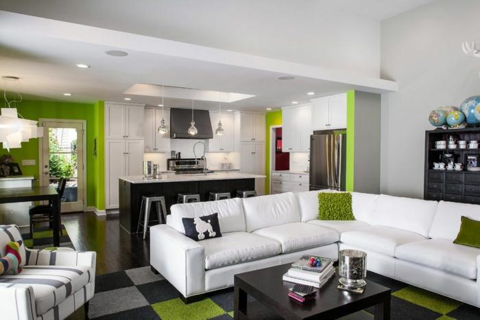 cocina americana con salón moderno, decoracion en colores claros con detalles en verde claro, paredes en blanco