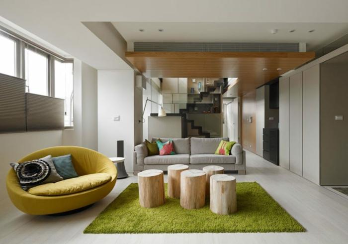 diseño de interiores original con interesante elementos arquitectónicos y muebles, decoracion salon moderno, sofá de forma oval en color mostaza