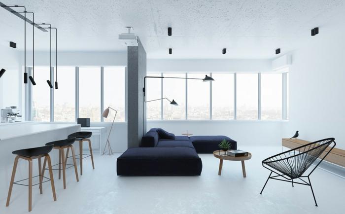precioso interior en blanco con sofá en negro y paredes y suelo en blanco, decoracion salon moderno con lámparas modernas y originales