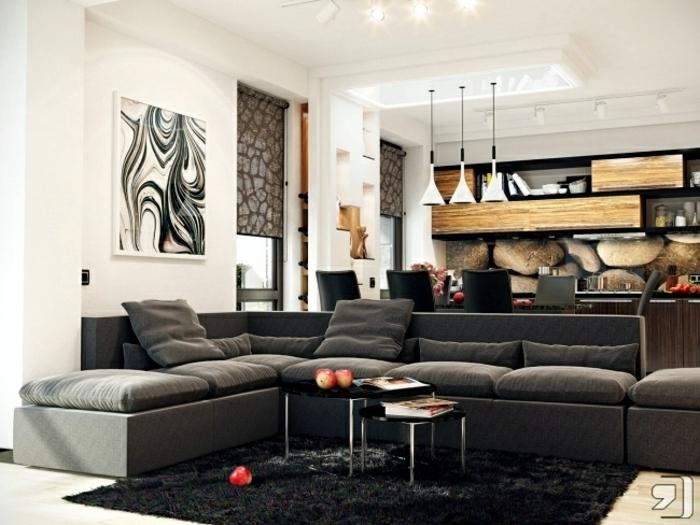 salon comedor de encanto decorado en tonos oscuros, detalles de madera y pintura en la pared, sofa moderna en gris oscuro