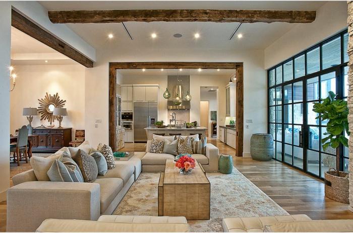 interesante propuesta de diseño para pisos de una planta alargada, colores cálidos y claros, salon comedor de diseño moderno