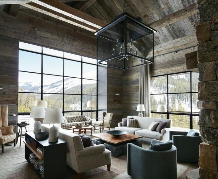 buhardilla acogedor con paredes tapizados en madera, decoracion salon moderno con muebles funcionales y modernos en beige y gris y suelo de moqueta