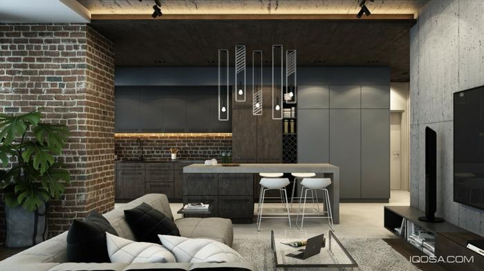 decoracion de salon comedor en estilo industrial, colores oscuros, detalles con ladrillos y hormigón, sofá en beige cómoda