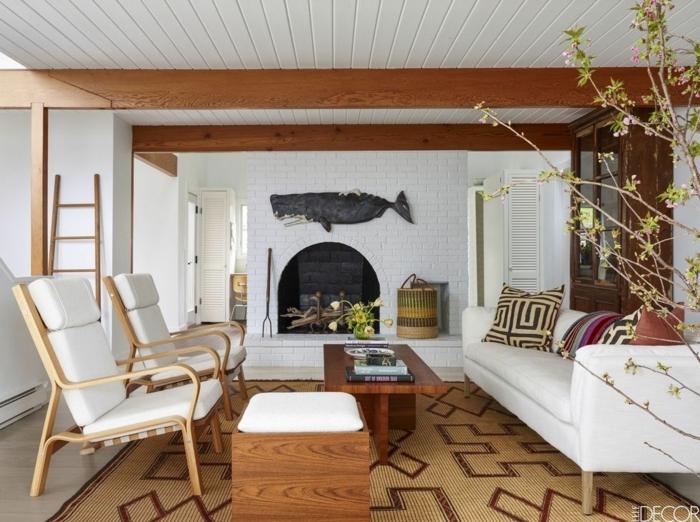 salon grande dividido en diferentes zonas, chimenea de leña y paredes de ladrillo, muebles de salon modernos de diseño en estilo minimalista