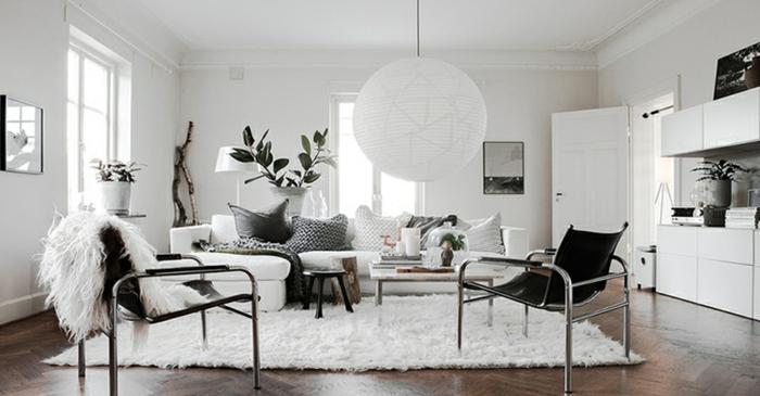 precioso salon de tamaño grande decorado en blanco y negro, ejemplos de muebles de salon modernos de diseño