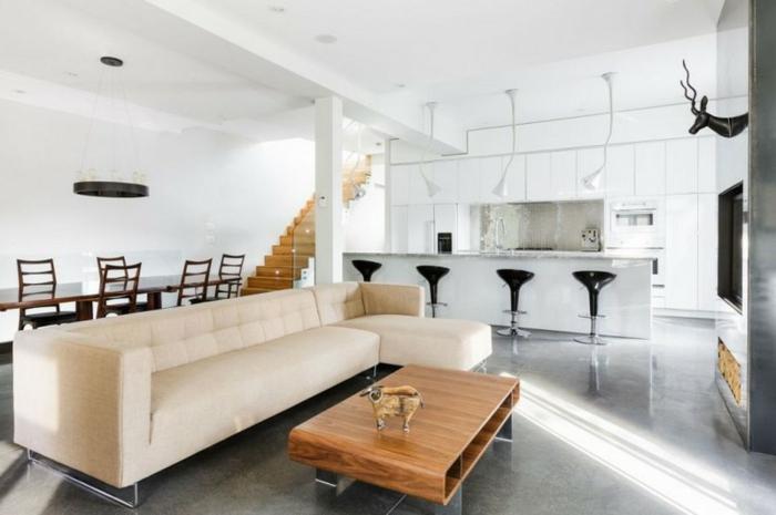 ambiente decorado en estilo nordico, espacio grande y luminoso en blanco con detalles en negro, cocinas abiertas al salon de encanto