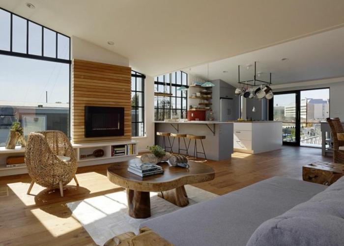 ejemplo de un piso con espacios abiertos, como amueblar las cocinas abiertas al salon, decoración en colores calidos y claros
