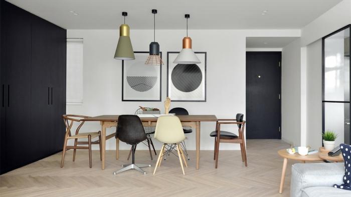 decoracion estilo nordico, comedor con aprquet, mesa rectangular de madera, sillas desparejas, tres lámparas colgantes, cuadros con círculos, blanco y negro, armario grande, mesita de café redonda