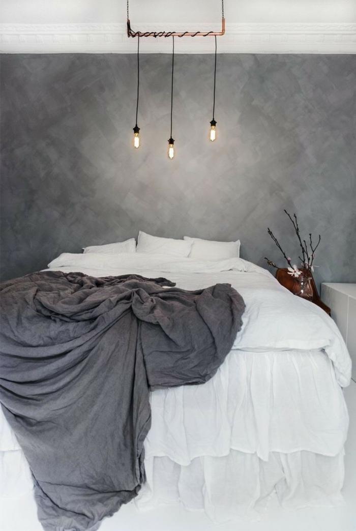 dormitorio moderno con cama doble, lamparas colgantes, pared pintada gris con efecto de esponja, habitacion gris