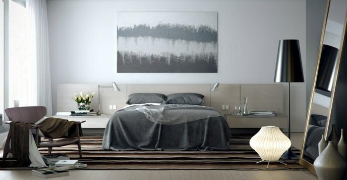 dormitorio moderno, cama doble, cabecero con mesillas de noche integradas, dormitorios matrimonio, espejo grande apoyado en el suelo, salfombra en rayas tonos marron