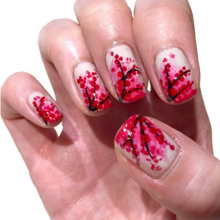 motivos florales en rojo, uñas de gel decoradas de árboles florecientes, base en color nude, ideas origin