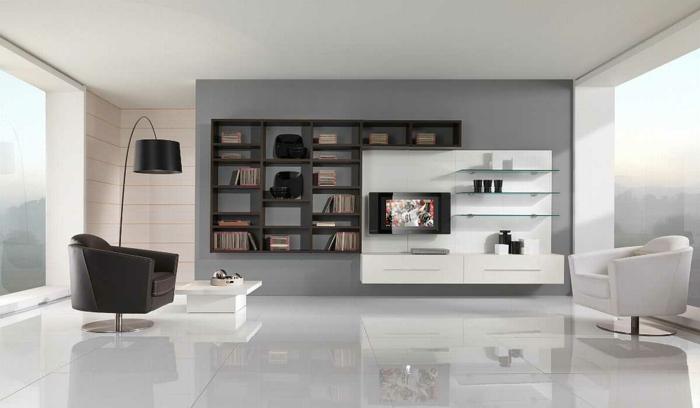 salón con biblioteca con zonas de contraste, decoracion salon en blanco y negro con estanterías de diseño moderno