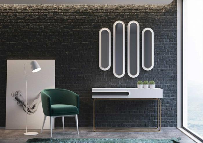 bonita habitación decorada en estilo minimalista, con espejos plateados de diseño original, silla tapizada en terciopelo verde