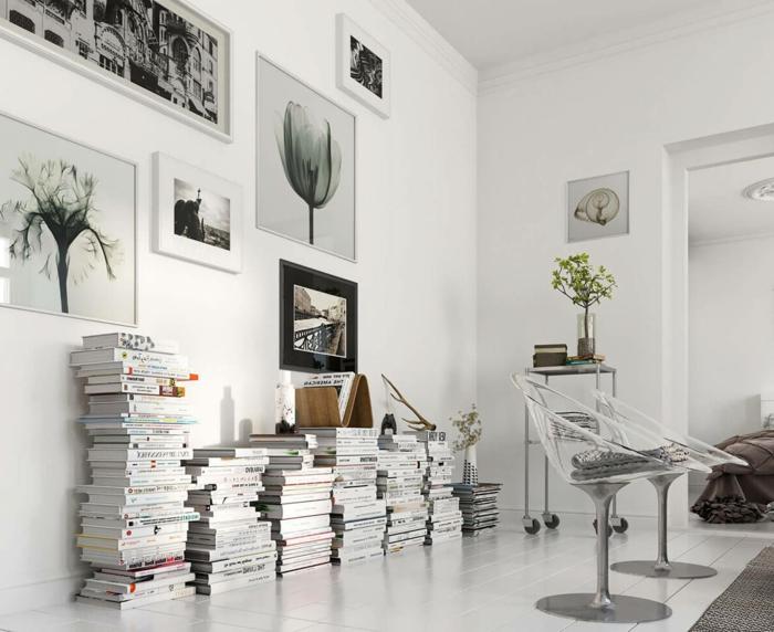 decoracion en blanco y gris, decoracion estilo nordico, salón con sillas transparentes de plástico, pilas de libros, fotografias en blanco y negro de paisaje urbano y flores, suelo con tarima blanca