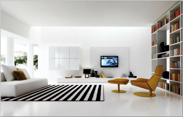 decoracion salon moderna en estilo minimalista, sillones en color mostaza, grande librería y alfombra en rayas en blanco y negro