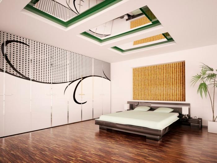habitación decorada en estilo contemporáneo con detalles en verde y espejos decorativos en el techo, macetero con plantas verdes
