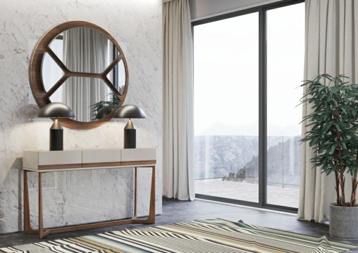 espejos de pared de encanto en forma oval, habitación en estilo moderno con grandes ventanales y decoración de plantas verdes