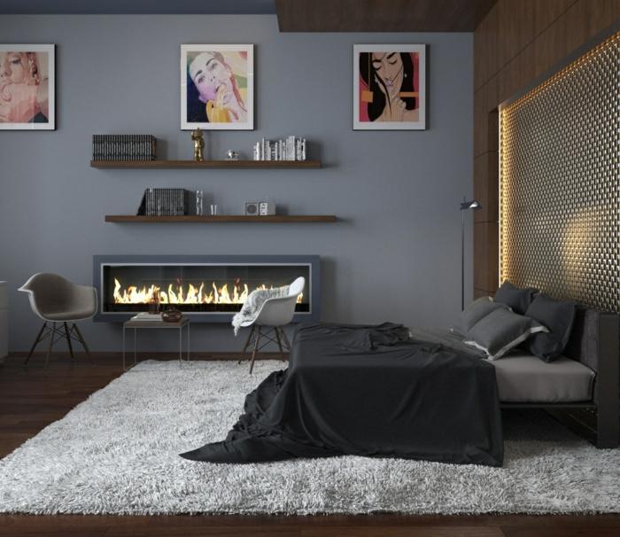 habitación gris, paredes gris pizarra, cama doble, ropa de cama negra, chimenea decorativa, alfombra peluda blanco sucio, cuadros con personajes de comic