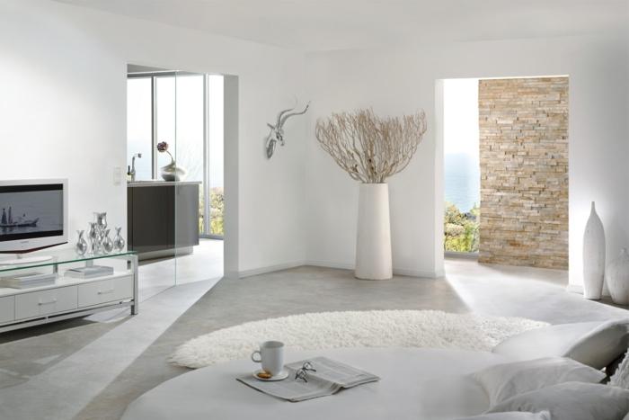 salones de diseño decorado en blanco, interesantes elementos arquitectónicos, pared de ladrillo y vinilo decorativo