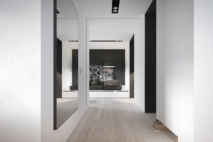interior en blanco y gris, grande recibidor en estilo minimalista con decoración de espejos grandes de pared