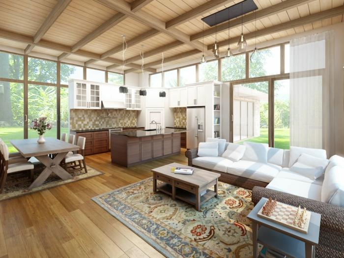 como atraer la luz en un cocina comedor, grande espacio con áreas definidas con la ayuda de alfombras, sofá tapizado en blanco