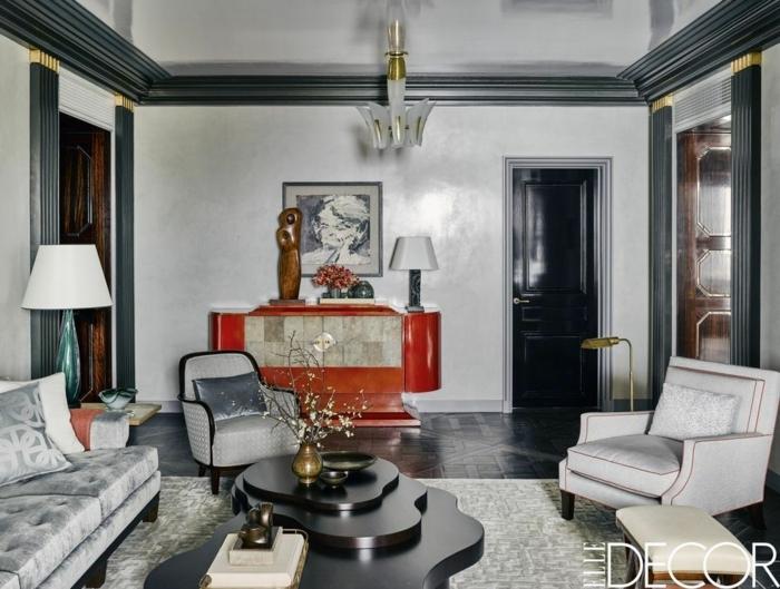 espacio decorado en estilo vintage minimalista, muebles de salon modernos en capitoné, paredes en blanco y gris