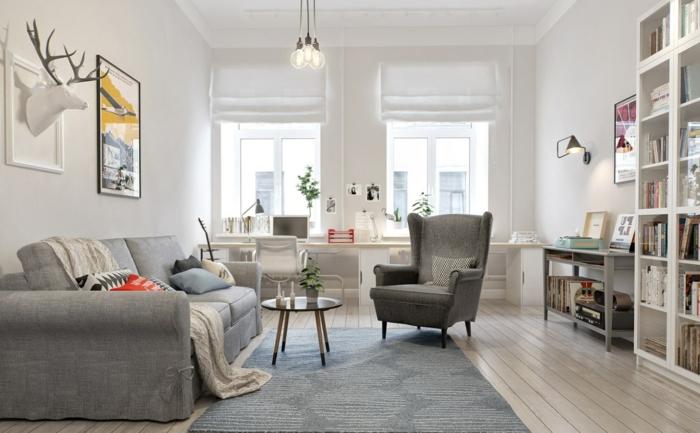 salón con sofá y sillón vintage, suelo con tarima, librería alta de madera blanca, bombillas colgantes, decoracion en blanco y gris, decoracion nordica